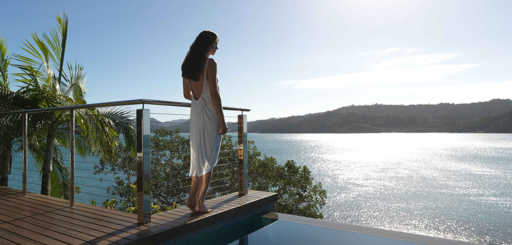 qualia_Great-Barrier-Reef_Woman-Standing-Plunge-Pool-